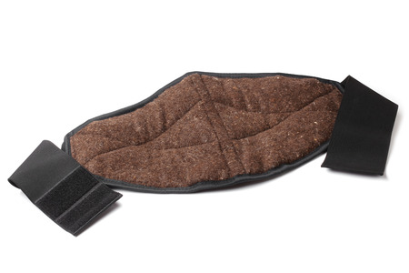posture correction: Lumbar warming belt made of natural dog wool on white background