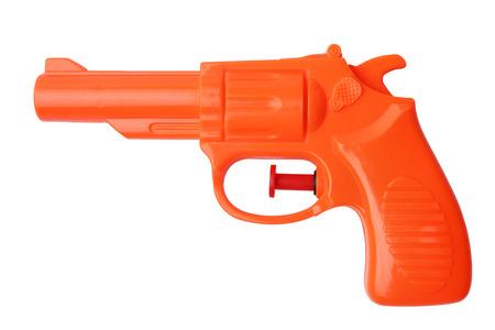 hand gun: Orange plastic water pistol isolated on white background Stock Photo