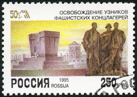 end of the world: RUSSIA - CIRCA 1995: A stamp printed in Russia shows Monument to concentration camp victims, devoted End World War II, 50th Anniversary, circa 1995