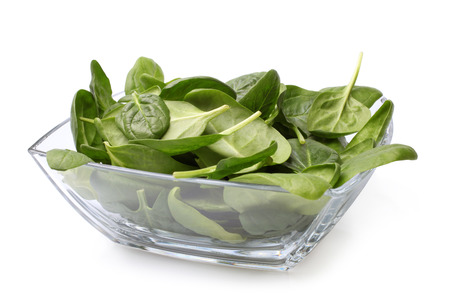 baby spinach: Glass bowl of fresh spinach on white background Stock Photo
