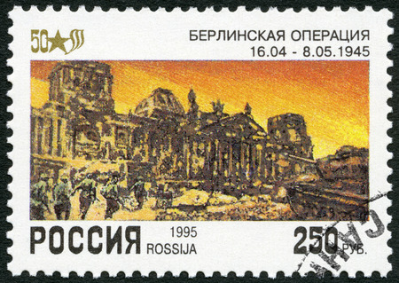 end of the world: RUSSIA - CIRCA 1995: A stamp printed in Russia shows Ruins of Reichstag, Berlin, devoted End World War II, 50th Anniversary, circa 1995 Editorial