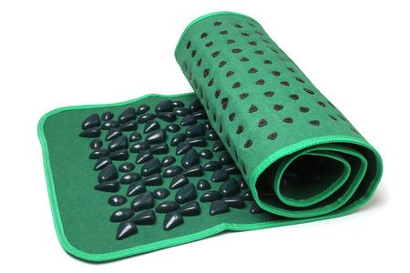 orthopedics: Foot massage mat (stone road) on white background