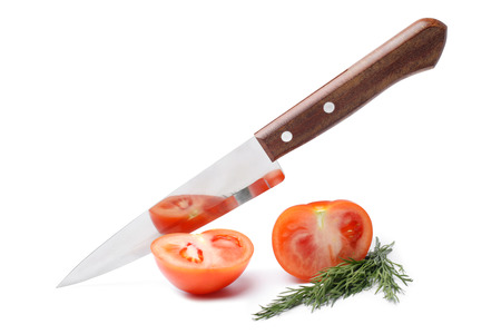 knife tomato: Fresh tomato with knife on white background
