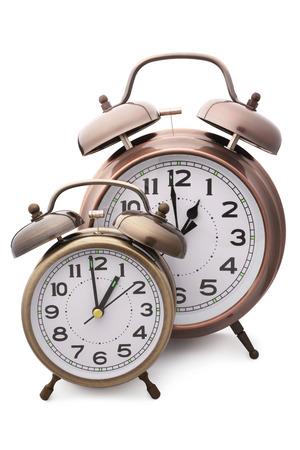 Alarm clocks on white background photo