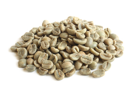 Green coffee beans on white background photo