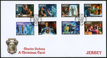 novelist: JERSEY - CIRCA 2012: A stamp printed in Jersey shows illustrations from A Christmas Carol, 200th anniversary of Charles Dickens(1812-1870), circa 2012 Editorial