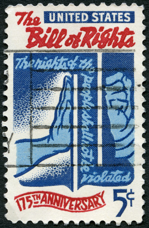 bill of rights: UNITED STATES OF AMERICA - CIRCA 1966: A stamp printed in USA shows Freedom Checking Tyranny, devoted to Bill of Rights, 175th Anniversary, circa 1966 Editorial
