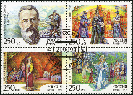 episodes: RUSSIA - CIRCA 1994: A stamp printed in Russia shows the picture of N.A. Rimsky-Korsakov, based on an archival photo with an episodes from the operas, The 150th birth anniversary of the composer (1844-1908), circa 1994 Editorial