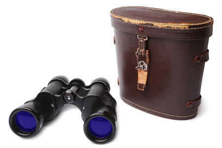 Old binoculars and leather case on white background photo
