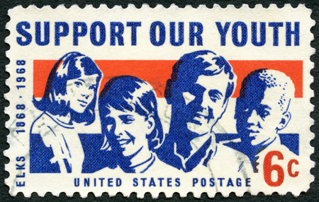 united states postal service: UNITED STATES OF AMERICA - CIRCA 1968: A stamp printed in USA shows Girls and Boys, dedicated to the 100th anniversary of the Youth program, circa 1968