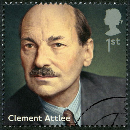 ministers: UNITED KINGDOM - CIRCA 2014: A stamp printed in United Kingdom shows Clement Attlee (1883-1967), politician, series Prime Ministers, circa 2014