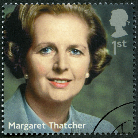 ministers: UNITED KINGDOM - CIRCA 2014: A stamp printed in United Kingdom shows Margaret Thatcher (1925-2013), politician, series Prime Ministers, circa 2014