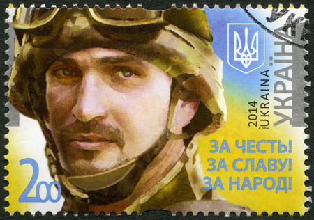 UKRAINE - CIRCA 2014: A stamp printed in Ukraine shows portrait of soldier with the call sign \Frenchman\, devoted Legends of the Armed Forces of Ukraine, For the honor! For the glory! For the people!, circa 2014