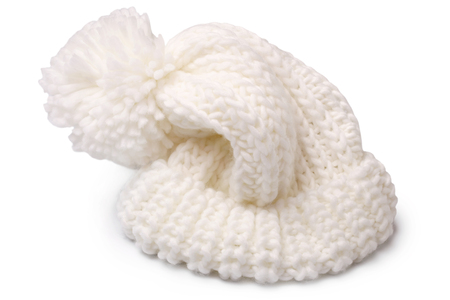 spliced: Warm woolen knitted hat with pompon on white background