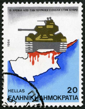 postmail: GREECE - CIRCA 1984: A stamp printed in Greece shows tank and map, devoted Turkish Invasion of Cyprus, 10th anniversary, circa 1984 Editorial