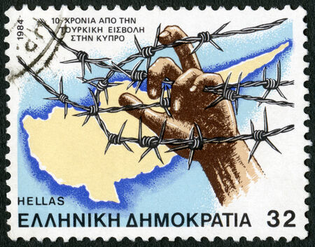 GREECE - CIRCA 1984: A stamp printed in Greece shows map and barbed wire, devoted Turkish Invasion of Cyprus, 10th anniversary, circa 1984