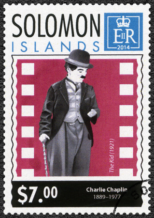 chaplin: SOLOMON ISLANDS - CIRCA 2014: A stamp printed in Solomon Islands shows portrait of Charlie Chaplin (1889-1977), 125th anniversary of birthday, circa 2014