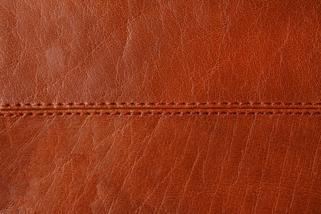 cow hide: Natural brown leather background closeup