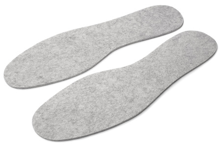 insoles: Felted insoles for shoes on white background Stock Photo