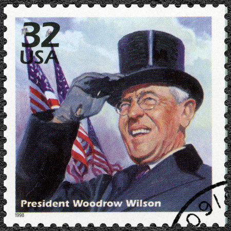 president: UNITED STATES OF AMERICA - CIRCA 1998: A stamp printed in USA shows Woodrow Wilson, series Celebrate the Century, 1910s, circa 1998 Editorial