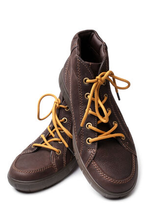 Leather brown boots on white background photo