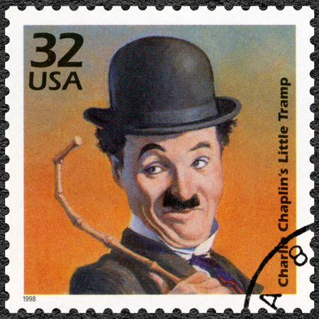 chaplin: UNITED STATES OF AMERICA - CIRCA 1998: A stamp printed in USA shows portrait of Charlie Chaplin (1889-1977), series Celebrate the Century, 1910s, circa 1998