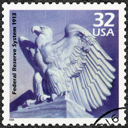 federal reserve: UNITED STATES OF AMERICA - CIRCA 1998: A stamp printed in USA shows Federal Reserve System created, 1913, series Celebrate the Century, 1910s, circa 1998