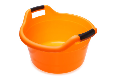 lave: Orange plastic wash bowl on white background