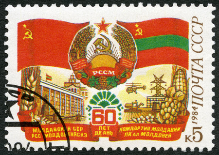 postmarked: USSR - CIRCA 1984: A stamp printed in USSR shows Russian flag and arms, Moldavian flag, devoted Moldavian SSR, 60th anniversary, circa 1984