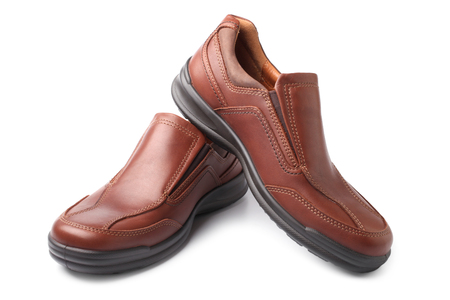 Brown shoes on white background photo
