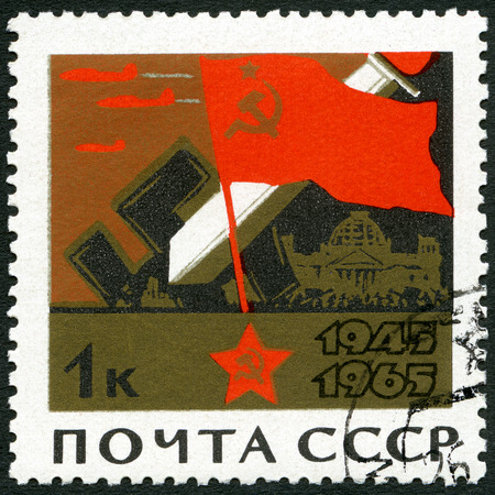 end of world: USSR - CIRCA 1965: A stamp printed in USSR shows Soviet Flag, Broken Swastikas, Fighting in Berlin, devoted 20th Anniversary of the end of World War II, circa 1965
