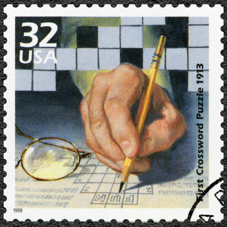 published: UNITED STATES OF AMERICA - CIRCA 1998: A stamp printed in USA shows First crossword puzzle published, 1913, series Celebrate the Century, 1910s, circa 1998 Editorial