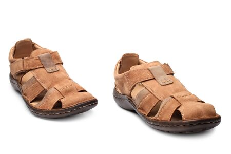 footgear: Pair of male summer sandals on white background Stock Photo