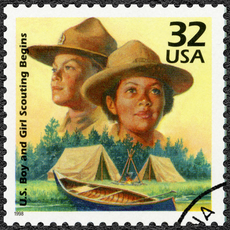 scouts: UNITED STATES OF AMERICA - CIRCA 1998: A stamp printed in USA shows Boy Scouts started in 1910, Girl Scouts formed in 1912, series Celebrate the Century, 1910s, circa 1998 Editorial