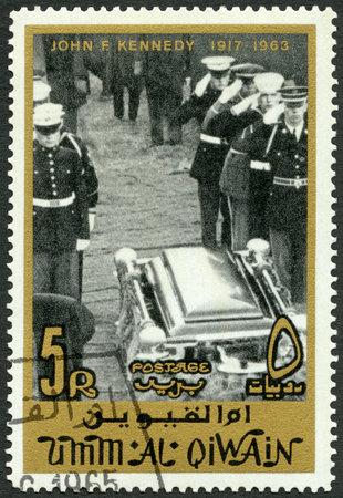assassinated: UMM AL-QUWAIN - CIRCA 1965: A stamp printed in Umm al-Quwain shows Honor guard at tomb, John F. Kennedy (1917-1963), circa 1965 Editorial