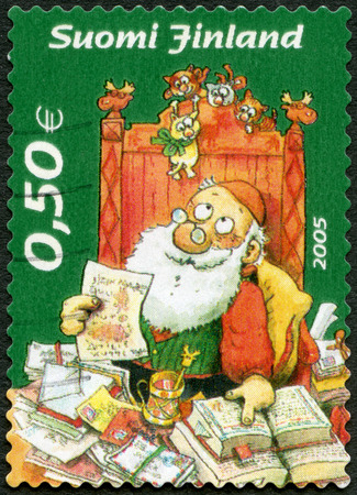 FINLAND - CIRCA 2005: A stamp printed in Finland shows Santa Claus reading letters, circa 2005