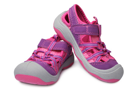 Baby girl shoes on white background photo