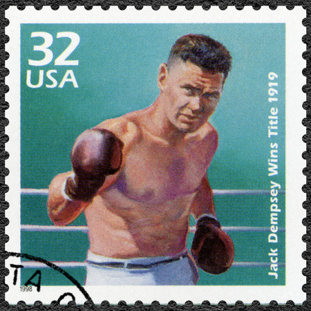 the heavyweight: UNITED STATES OF AMERICA - CIRCA 1998: A stamp printed in USA shows Jack Dempsey wins heavyweight title, 1919, series Celebrate the Century, 1910s, circa 1998