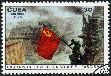 CUBA - CIRCA 1975: A stamp printed in Cuba shows Raising red flag over Reichstag, Berlin, 30th anniversary of the the Victory Over Fascism, circa 1975 Editöryel
