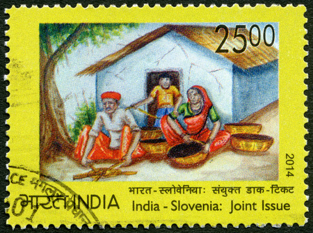 indian postal stamp: INDIA - CIRCA 2014: A stamp printed in India dedicate Universal Childrens Day, 25th anniversary of the Convention on the Rights of the Child, Joint issue India - Slovenia, circa 2014