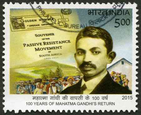 ideological: INDIA - CIRCA 2015: A stamp printed in India shows portrait of Mohandas Karamchand Gandhi (1869-1948), anniversary 100 years of Mahatma Gandhi return, circa 2015