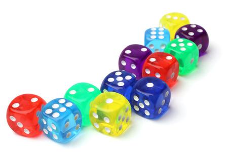 Many-colored dice set on white background Stock Photo