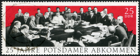concerning: GERMANY - CIRCA 1970: A stamp printed in Germany dedicate 25th anniversary of the Potsdam Agreement among the Allies concerning Germany at the end of WWII, Potsdam Conference in 1945 with Winston Churchill, Harry S. Truman and Joseph Stalin, circa 1970 Editorial
