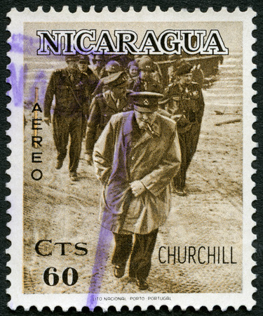 winston: NICARAGUA - CIRCA 1966: A stamp printed in Nicaragua shows Sir Winston Churchill (1874-1965), On military inspection as young officer, circa 1966
