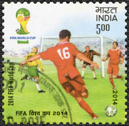 12 13: INDIA - CIRCA 2014: A stamp printed in India shows soccer players, dedicated the 2014 FIFA World Cup Brazil, June 12 - July 13, circa 2014