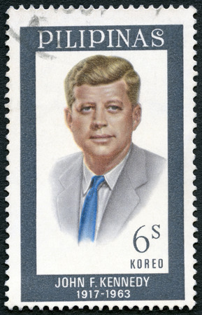 assassinated: PHILIPPINES - CIRCA 1965: A stamp printed in Philippines shows Portrait of John F. Kennedy (1917-1963), circa 1965