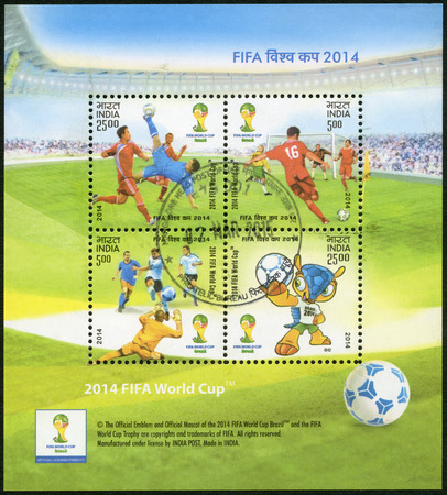 12 13: INDIA - CIRCA 2014: A stamp printed in India shows soccer players and Fuleco, dedicated the 2014 FIFA World Cup Brazil, June 12 -  July 13, circa 2014 Editorial