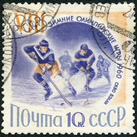 olympic sports: USSR - CIRCA 1960: A stamp printed in USSR shows Ice Hockey players, series dedicated VIII Olympic Winter Games in Squaw Valley, California, USA, 1960, Olympic winter Sports, circa 1960