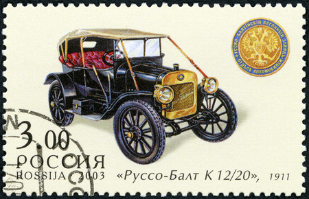 motorcar: RUSSIA - CIRCA 2003: A stamp printed in Russia shows Russo-Balt K 1220, made in 1911, series the history of Russian motor-cars, circa 2003 Editorial