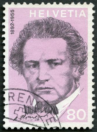 composer: SWITZERLAND - CIRCA 1972: A stamp printed in Switzerland shows Oscar Arthur Honegger (1892-1955), composer, series Portraits and Signatures, circa 1972